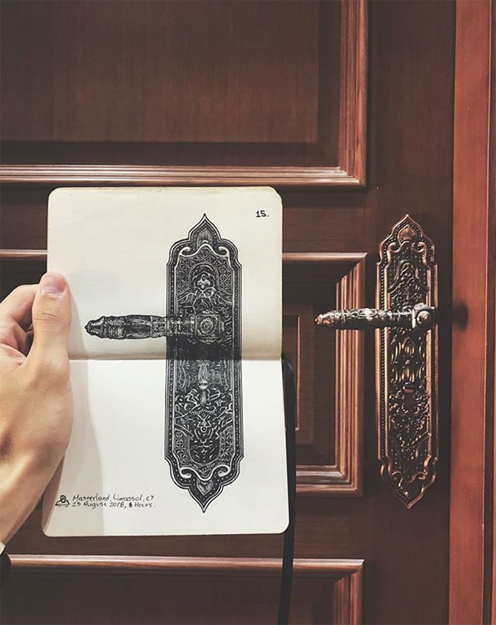 Detailed drawing of an elaborate door handle, side by side with the real door handle