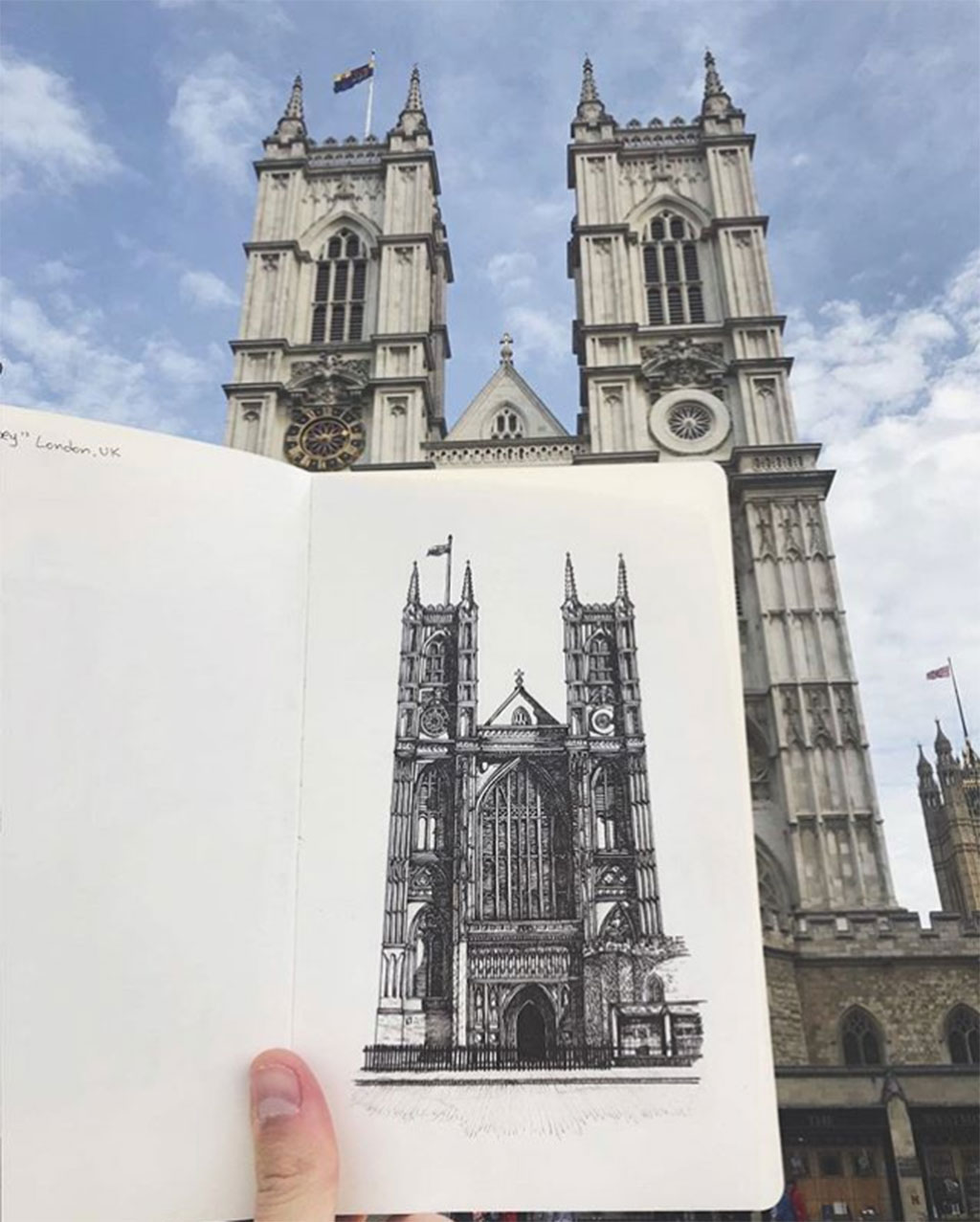 Drawing of Westminister Abbey with sketch held up to compare to the actual building
