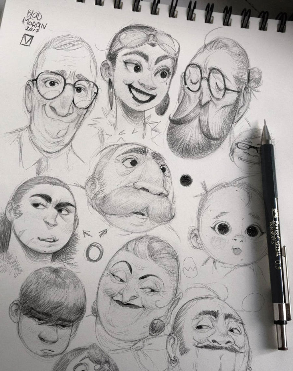 Drawing of multiple faces showing various expressions