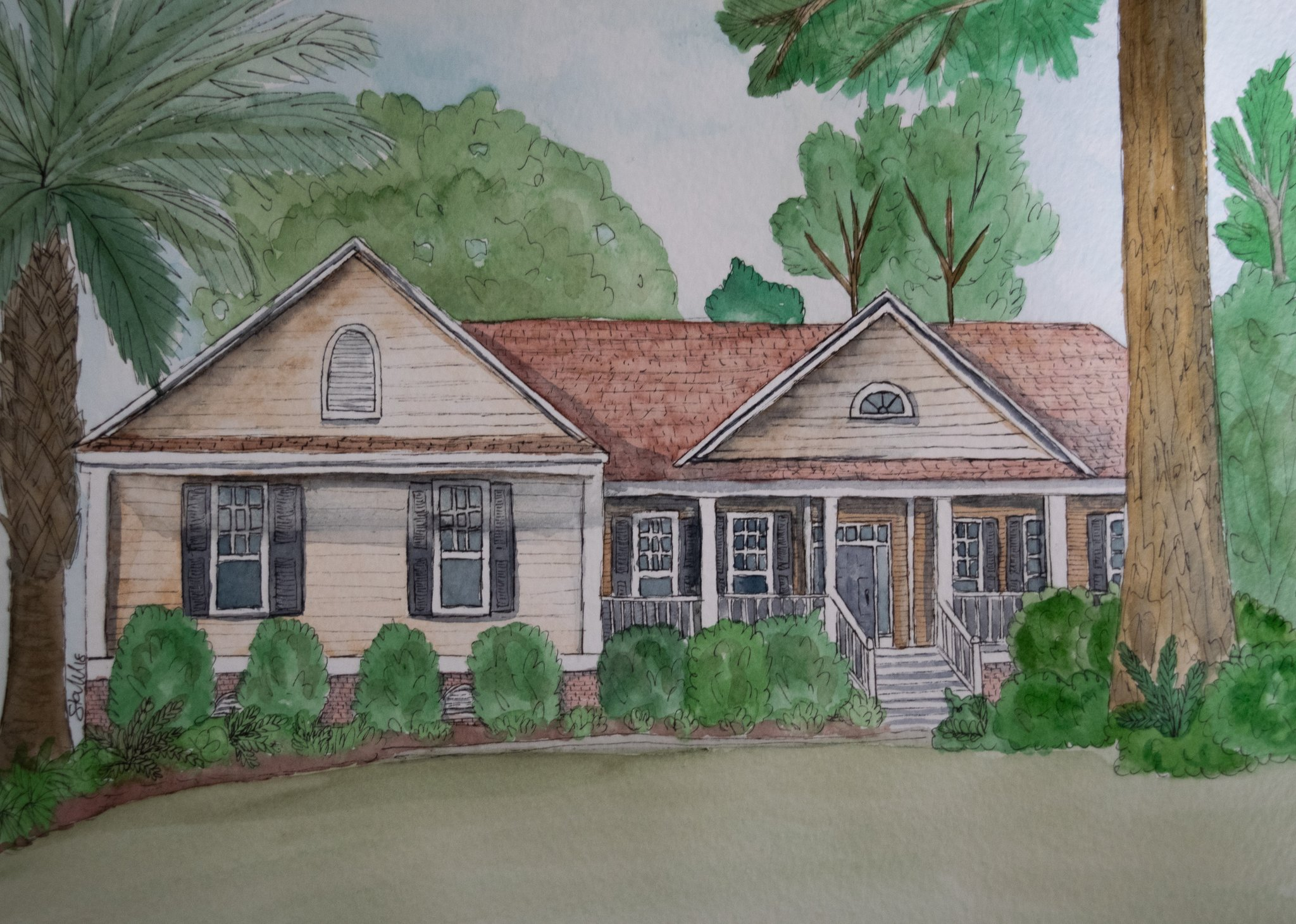A watercolor drawing of a ranch-style home
