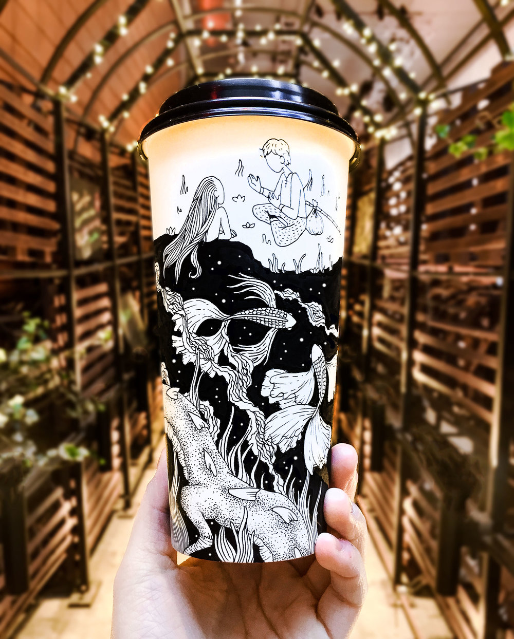 Pen drawings on a coffee cup